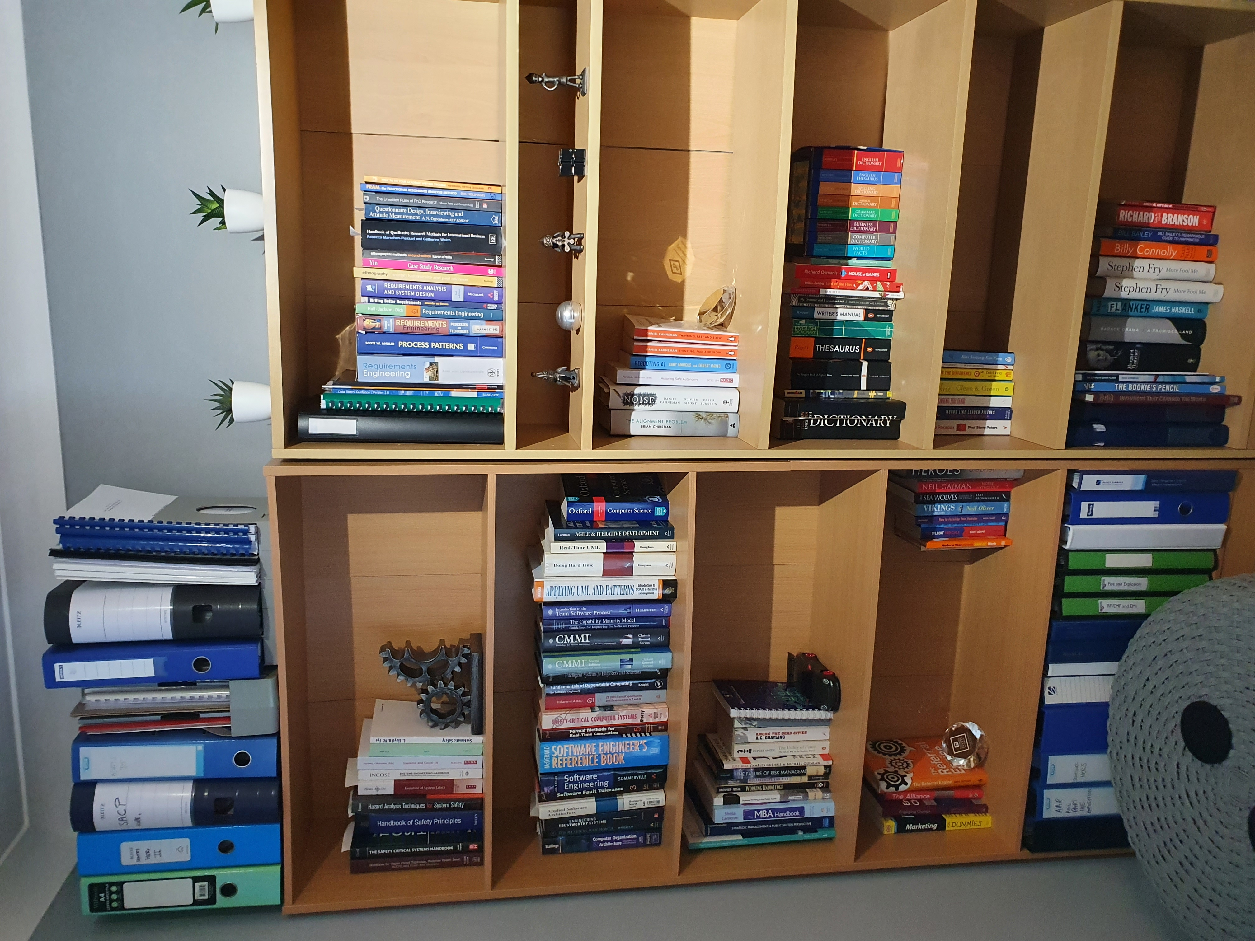 A picture showing 2 bookshelves with books on next to each other